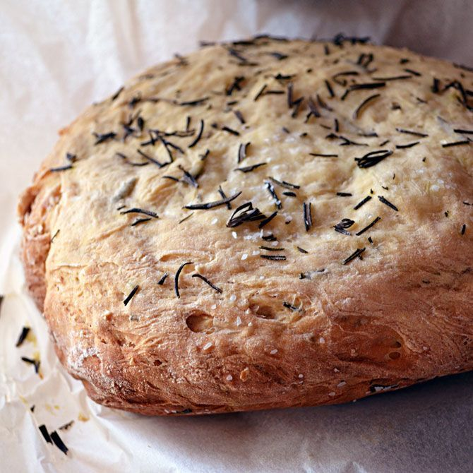 Rosemary Olive Oil Crock Pot/Slow cooker Bread. Tastes like  Macaroni Gril's. make in your slow cooker. Tips: you can skip the parchment paper and grease the cooker with oil and sprinkle in cornmeal. Can also make pull apart dinner rolls by cutting into 12 pieces, roll into balls, and then place inside the cooker.