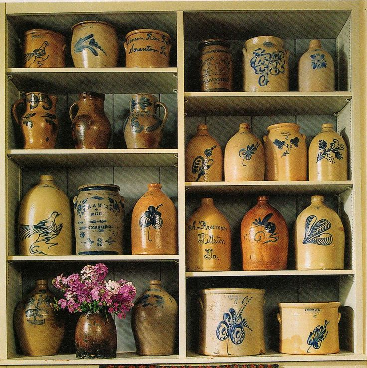 Prim Cupboard...filled with olde crocks..  Don't forget, these were the equivalent to 'tupperware' in 1800s