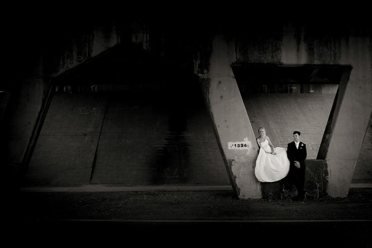 Bride & Groom + Arch under bridge B&W