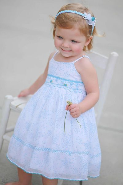 Wearing CarouselWear Light Blue Spring/Summer Dress with matching Headband
