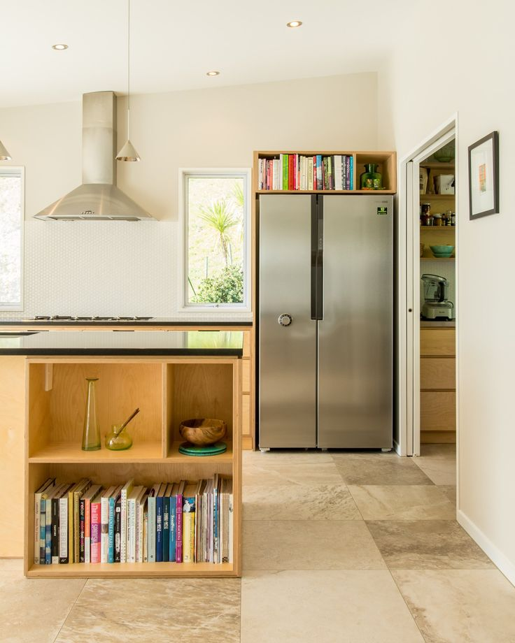 Crisp, simple and modern plywood kitchen. Oiled Birch plywood and absolute black honed granite. Lots of clever storage and a dream to work in.