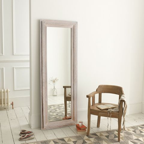 NICHE. This mirror had us at hello. It was the hand-carving and the faded white finish which did it for us.
