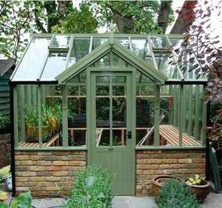 Charming greenhouse design idea!