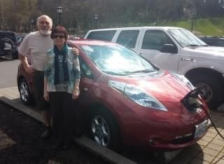 Rick and Linda SantAngelo with the 2011 Nissan Leaf at 96,000 miles