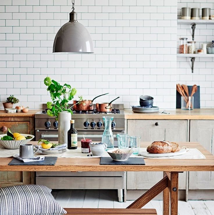 white kitchen with painted floorboards and rustic wooden bench the room edit