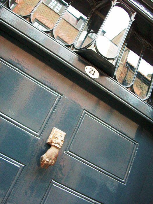 Beautiful fanlight with candle holder - creepy door-knocker.  Huguenot house #London #Spitalfields