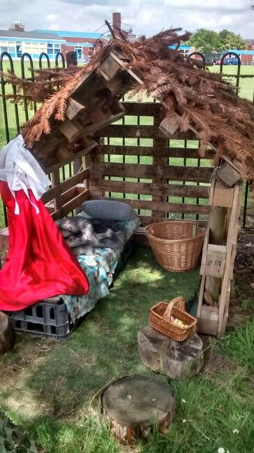 Role play hut made from pallets and cable ties.