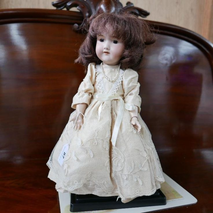 Vintage Armand Marseille porcelain doll available at our collectables auction.
