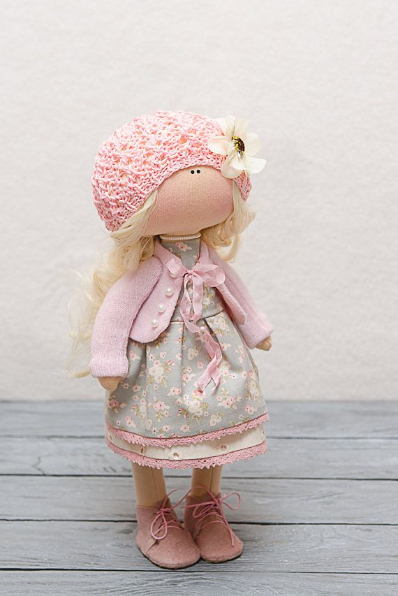 Welcome to our Little Corner - home to handmade toys with a story to tell.. Madelyn is a fabric doll, part of 30 cm of Happiness collection. She is an adorable little girl, so sweet and loving, that youll fall in love with her instantly. Madelyn likes to dance and make paper puppets, she uses for her shows. Secretly, she told me, when she grows up she would like to be an actress. I thought Its a wonderful idea, but it will take time and practice to become a good artist, so please do help…