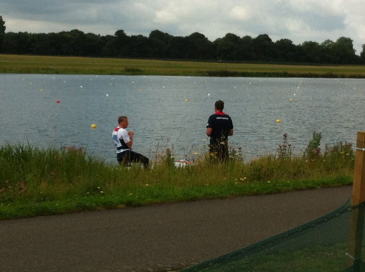 Team GB canoeist talks to his coach..