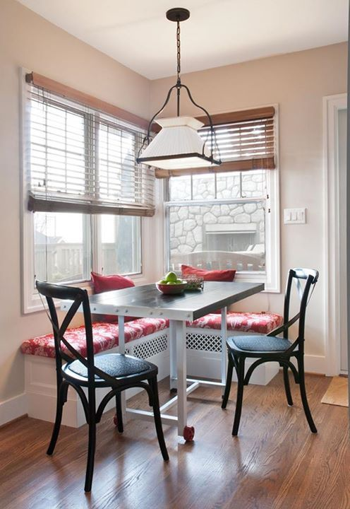 Breakfast nook with built in bench seating. Love the details on the bench and its use of space with a roll away table