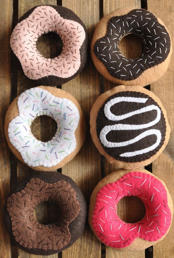 These donuts. What else can I say? Theyll bring out the child in anyone. The donuts are a combination of machine and hand stitching, and provide a tactile experience that plastic play food cant match. They are made from eco-friendly felt. Felt donuts are the perfect addition to any childs play kitchen or tea party. The donuts are available in 6 flavors: - chocolate with pink frosting and chocolate sprinkles - vanilla with chocolate frosting and vanilla sprinkles - vanilla with vanilla…
