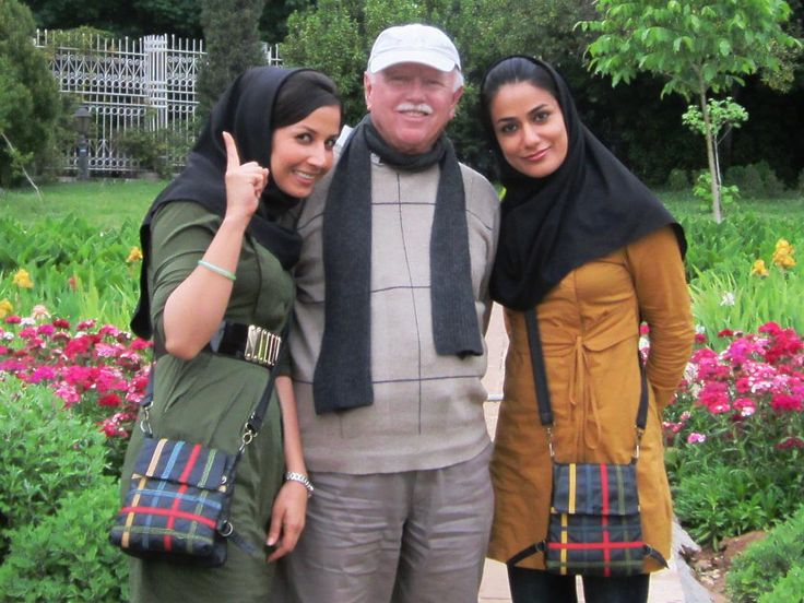 David Stanley with two Iranian students in the Bagh-e Eram or Garden of Paradise at Shiraz, Iran.
