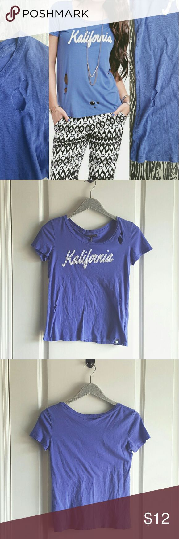 Kendall & Kylie Distressed Kalifornia Tee From their earlier line this Kendall and Kylie Kalifornia Tee sports a distressed look and is in EUC!! 🎉Every listing purchased enters you in for a gift card drawing at the end of the month. Kendall & Kylie Tops Tees - Short Sleeve