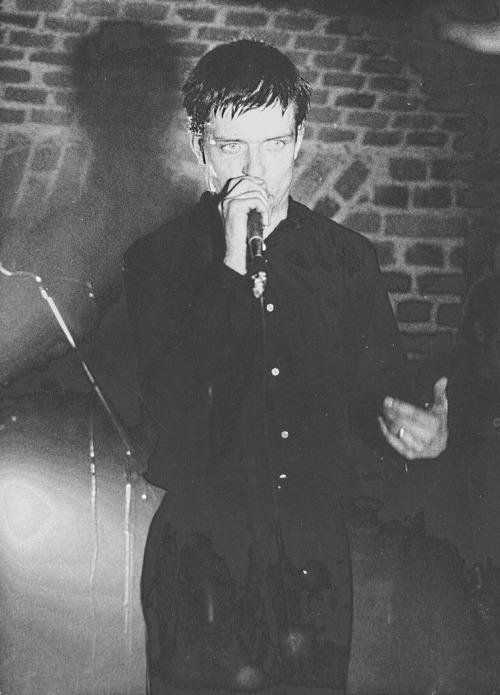 Ian Curtis of Joy Division performing at The Basement in Cologne, Germany.  1980.