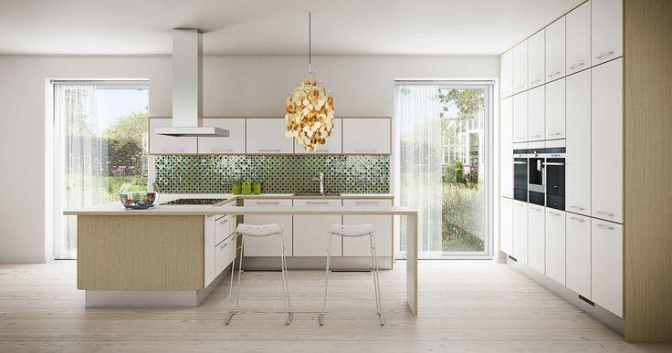 Invita - skabsvæg og så bordplader i den øvrige del af køkkenet. Så slipper man også for stænkplader! ;)