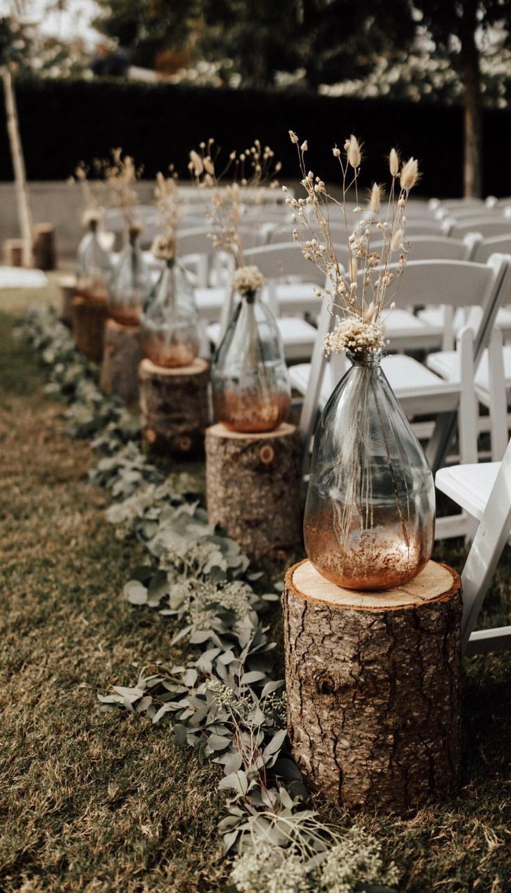 Shabby and chic bottles and greenry ceremony