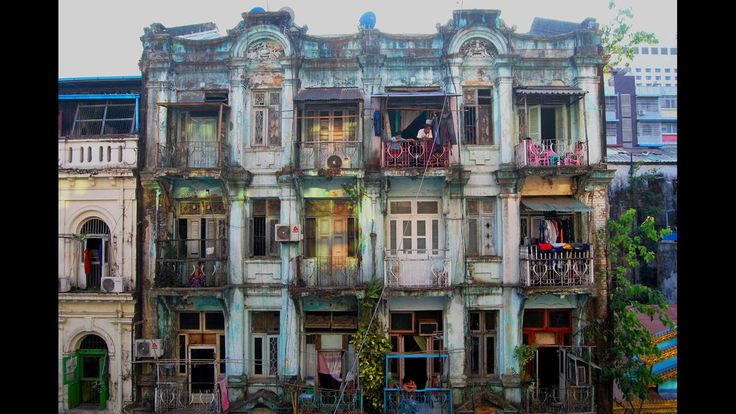 L.A. Times reader Julia Light, snapped this photo of a colorful dilapidated building bustling with life in Yangon, Myanmar.