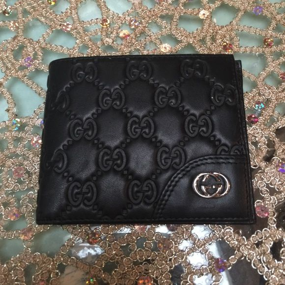 Black billfold Gucci wallet Black men's wallet with double g's all over front & back. Brand new make me an offer got as a gift not sure if 100% authentic but nothing wrong with the wallet. Gucci Bags Wallets
