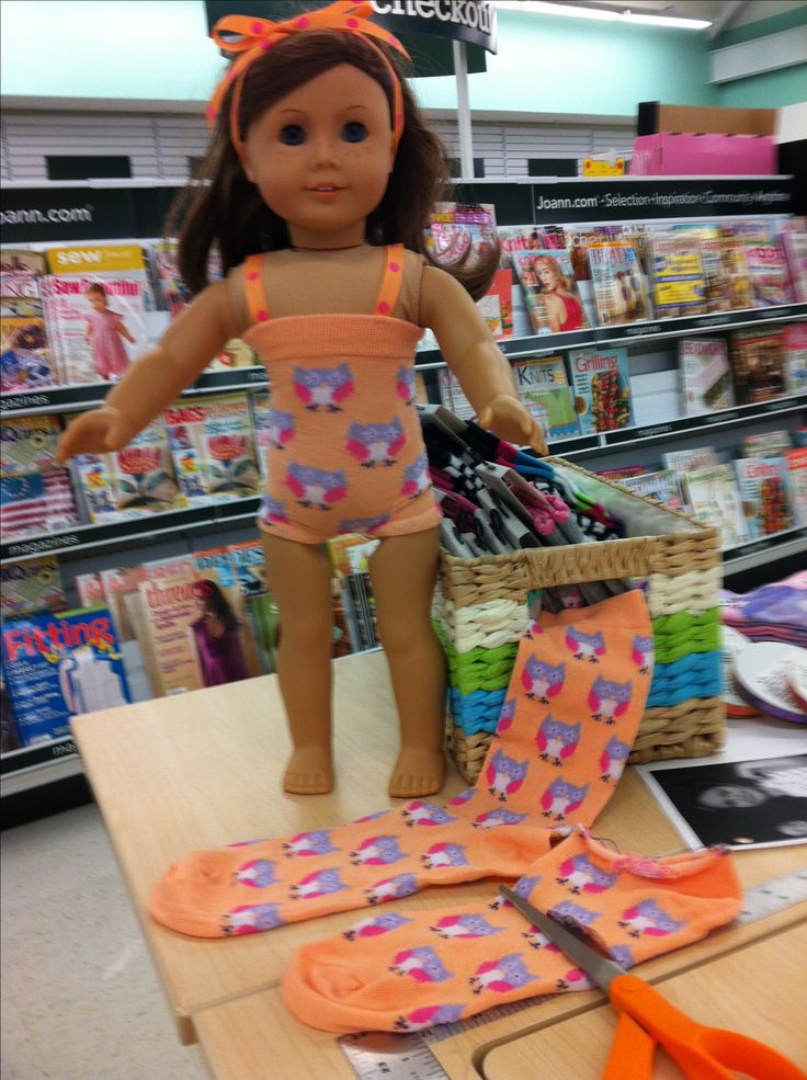 "Made this American Girl swim suit from a pair of socks! Cut off the sock, zig-zag stitch the cut end and sew the center for the legs. Add a matching ribbon for straps and viola, a cute summer outfit for her 18"" doll. I got my socks and ribbon at JoAnn's with a coupon!! Cost me less than $5.00!"