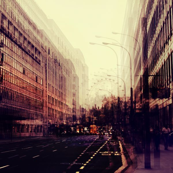 Multiple exposure of a street in London going towards the London Eye.