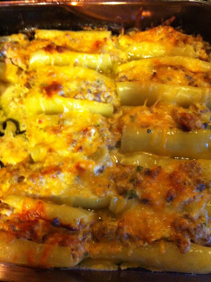 Stuffed banana peppers Super Easy and Delicious   Seed and half peppers (use large peppers) 1 lb Spicy Sausage Cream cheese 1 bell pepper (diced) 1 onion (diced) 2 cups shredded cheddar 2 tbs. olive oil( pour in baking dish)  Cook the sausage, onion, and bell pepper until browned. Drain then mix with cream cheese and 1 cup cheddar. Stuff peppers and place in baking dish. Sprinkle remaining cheese on top. Bake for 35 min at 350.