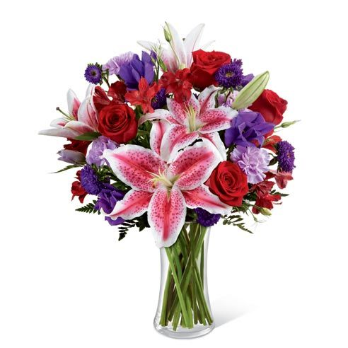 Wondrous Elegance Bouquet: red roses, pink stargazer lilies, purple double lisianthus, lavender carnations, purple matsumoto asters, and red Peruvian lilies. #flowers