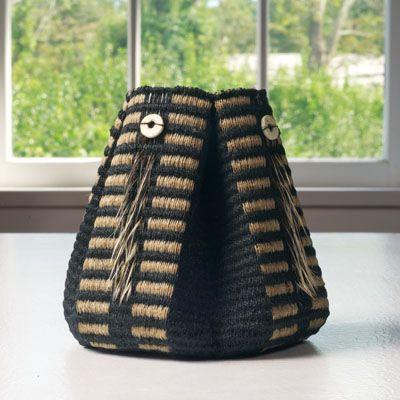 Basket by Birgit Birkkjaer of Copenhagen, Denmark. Linen, feathers, ostrich egg beads, glue