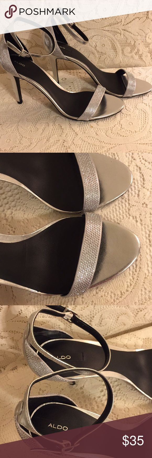 Glamorous Silver ALDO Heels Sz 10! Great pair of gently-worn silver ALDO heels, size 10. Glittery accents on strap that goes over toes & on back. Ankle strap shoes off your ankles. A few tiny marks on right heel and left side of the back of the right shoe - barely noticeable. Gorgeous with your spring and summer dresses or jeans! Aldo Shoes Heels