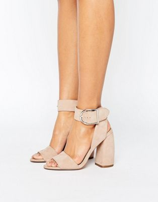 Fromt black heels to bright silver, browse our range of classic peep toes,  court shoes or strappy sandals from ASOS.