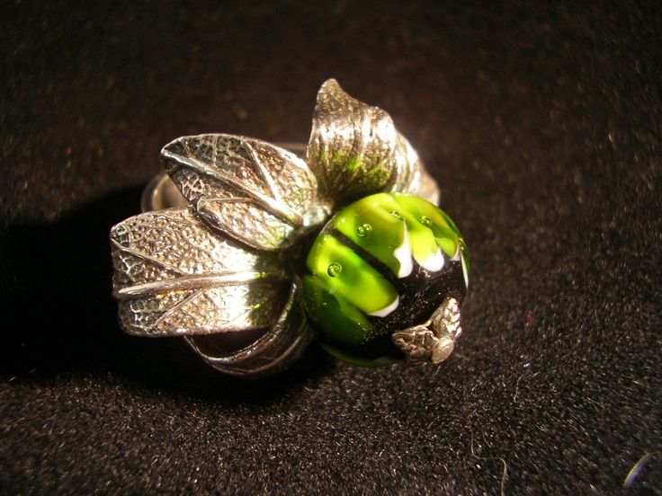 artclay with a glass bead
