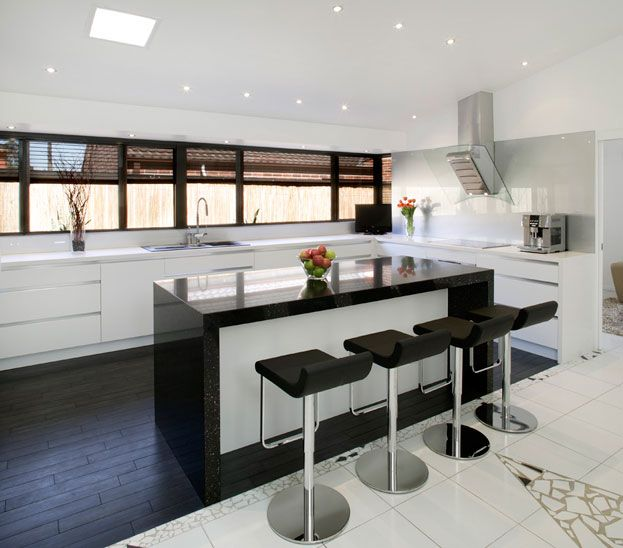 Great kitchen love long window, island bench and stools, great glass splashback  even the floor is fab