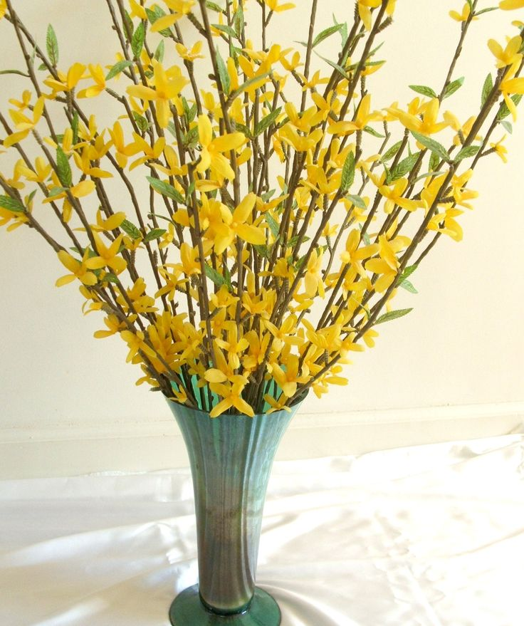 Spring flowers in green vase
