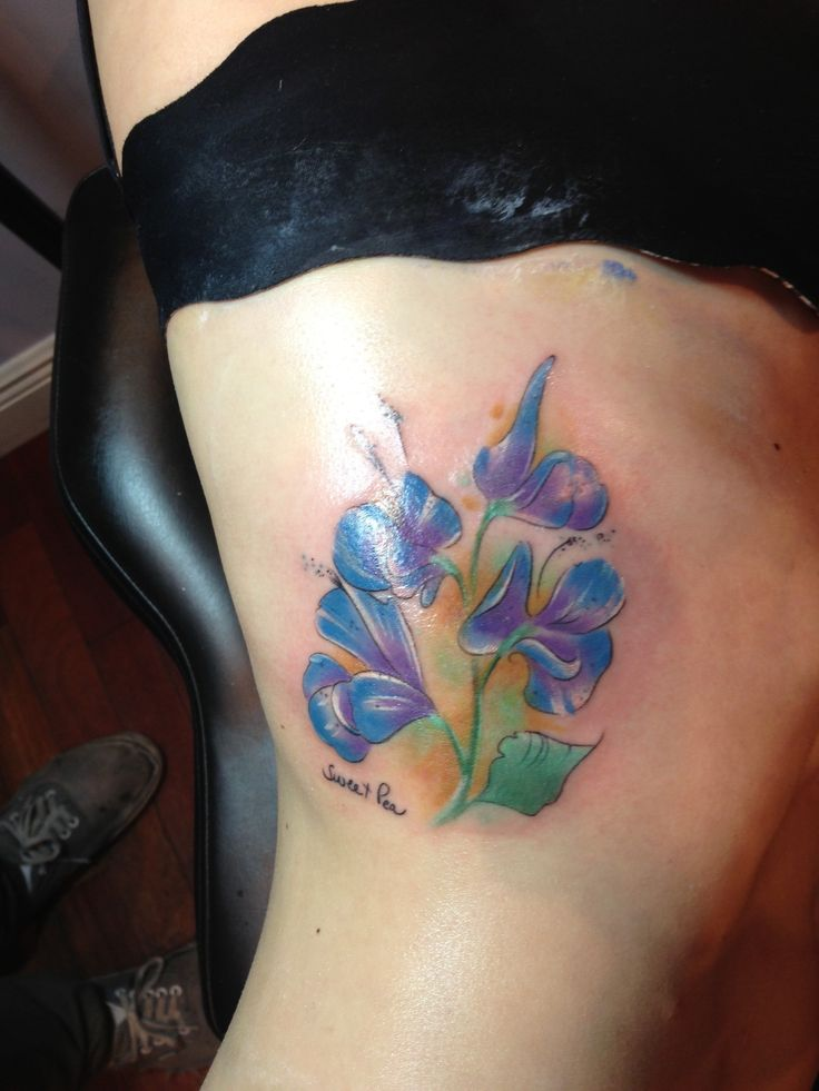 Tattoo done in honor of my mom. Her nickname for me is Sweet Pea, and thats what they are. Thats her handwriting on the side.