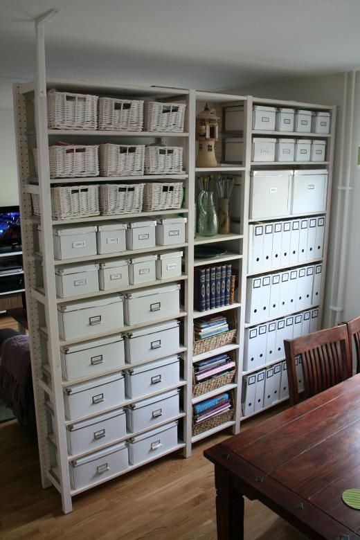 Ivar shelving dividing living room from kitchen, which is also used for a sewing area. Love how everything is neatly kept in IKEA Kasset boxes and magazine holders.