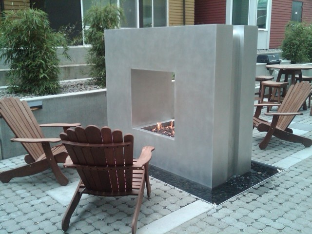 Gotta love the modern style of this outdoor space with double-sided fireplace.  #patio #outdoor #backyard