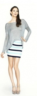 THE MOONSTONE is a fitted mini skirt with stripe bind detail. Made from a textur