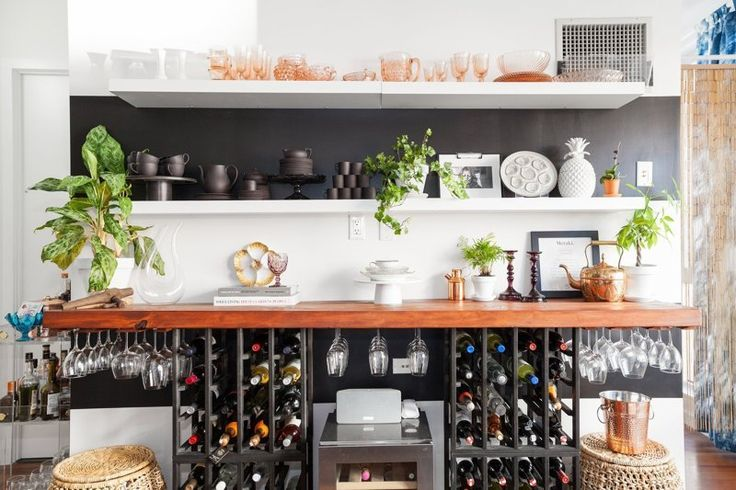 Shelf supported by wine rack with glasses under