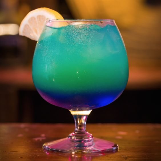 Sweet Poison: Light Rum, Coconut Rum, Blue Curacao, Pineapple Juice, Pineapple Wedge.