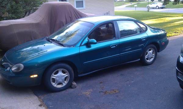 #13.. 1996 ford Taurus. Good gas mileage car.