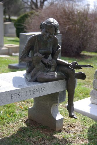 A good book in her hand and a cat in her lap, not a bad way to be preserved for eternity.