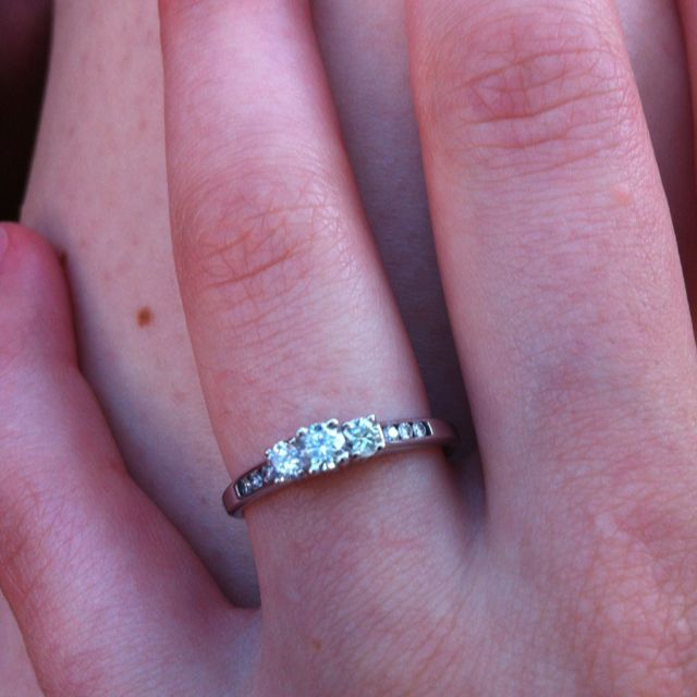 sweet and simple engagement ring.  I love it! I wouldn't mind this being my WEDDING RING!