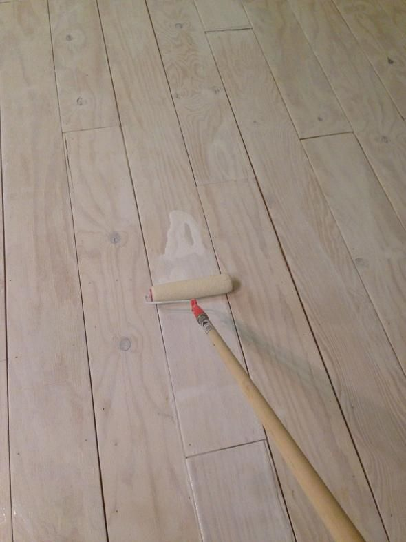 DIY-er @Jenny Komenda created a neat wide-plank flooring look with plywood and paint.