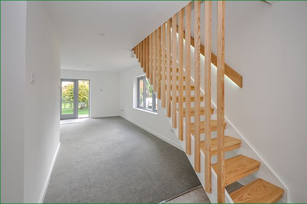 Open riser staircase with natural wood and white highlights