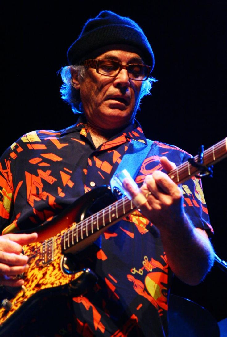 Ry Cooder - Composer, celebrated musician. Brilliant guitarist, especially slide guitar. Collaborates with other musicians around the the world, including from Cuba, India, etc. Comentates, through his songs on issues of greed and inequality.