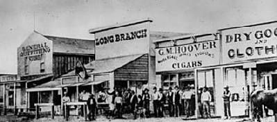 """Dodge City, Ks.   """"Kansas has but one Dodge City, with a broad expanse of territory sufficiently vast for an empire; we have only room for one Dodge City; Dodge, a synonym for all that is wild, reckless, and violent; Hell on the Plains.""""     -- A Kansas Newspaper in the 1870's"""