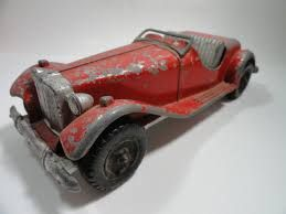 """Vintage Hubley Die Cast Toy Roadster $25 This is a #485 by Hubley and was made in the 1940's. It is the Roadster style and was originally painted red with gray metal on bottom. As you can see it was well loved and played with a lot. The car measures 8 3/4"""" from bumper to bumper, 3 5/8"""" W and 2 1/2"""" high."""