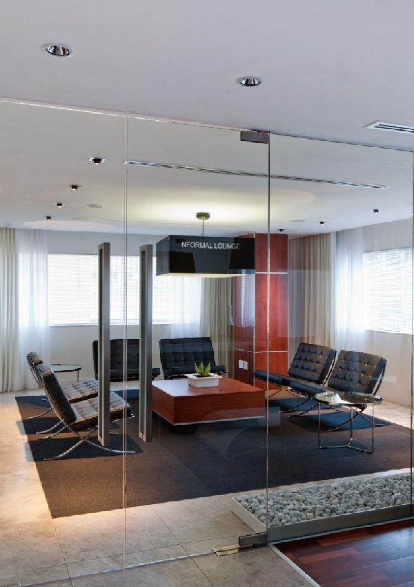 Informal lounge layout design in elegance deneys reitz for Modern office design layout