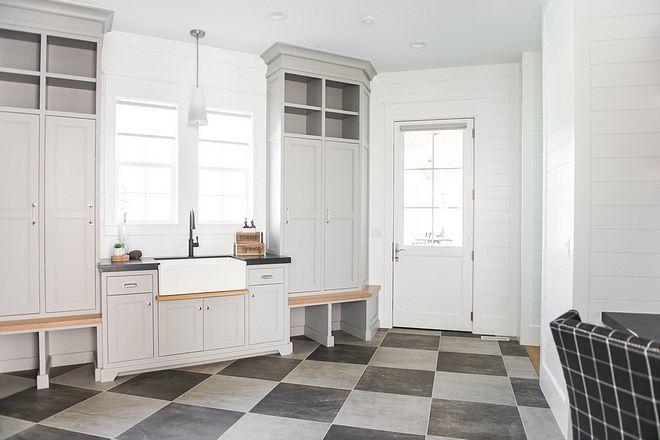The Main Floor Laundry Room Mudroom Includes A Farm Sink With Splash Guard Floor Cubbies Modern Farmhouse Design Luxury Interior Design Laundry Room Flooring