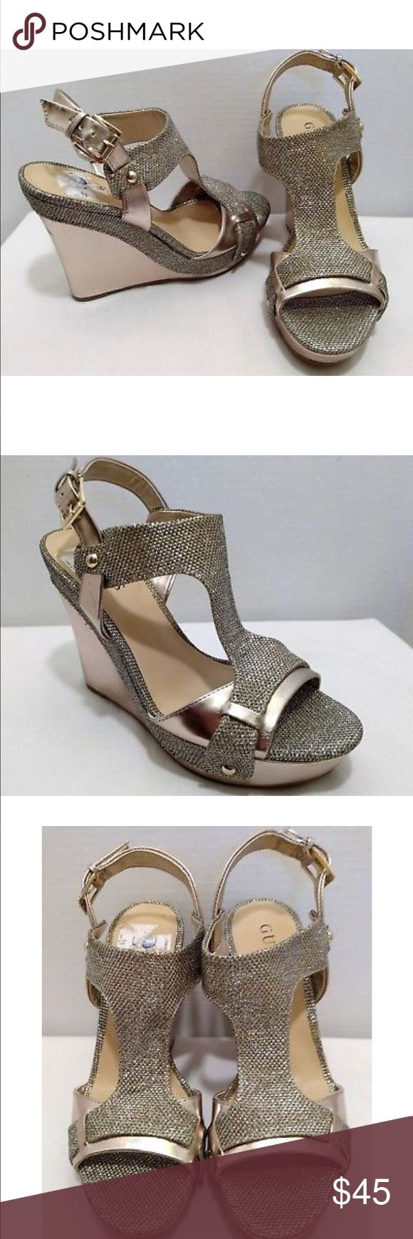 Guess Metallic Wedges Brand new without box. Size 10. Metallic wedge, has silver and gold notes. Platform wedge is 3.5 inches tall Guess Shoes Wedges